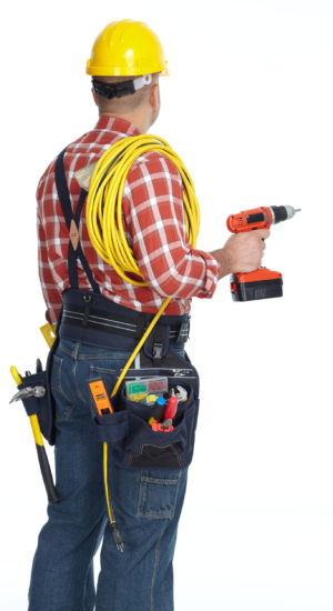Electrician man with drill and wire cable isolated on white background.